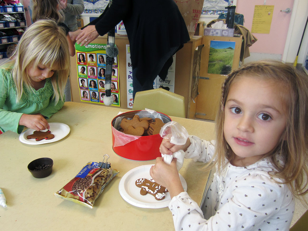 decorating gingerbread cookies at preschool