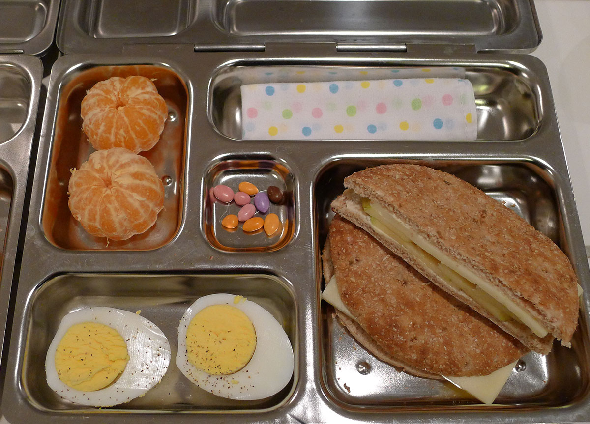 lunch on 6 February 2013: apple cheddar sandwich with a hard boiled egg and satsumas