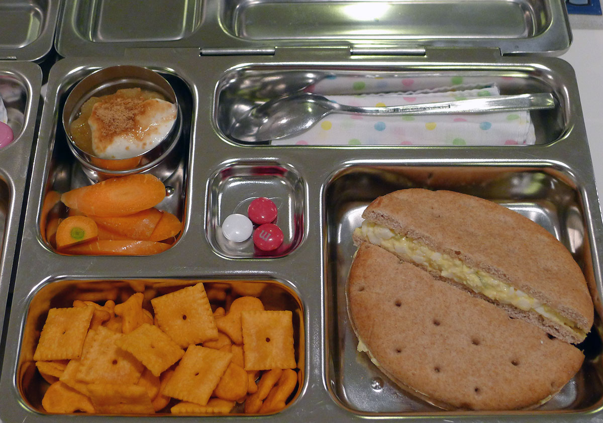 lunch on 21 Feb 2013: egg salad on skinny bread, cheesy crackers, carrots and yogurt
