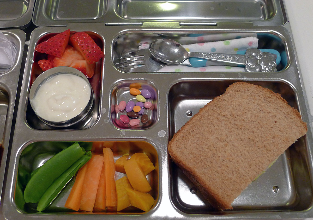 lunch on 6 March 2013: smoked turkey and sharp cheddar sandwich with veggies, strawberries and lemon yogurt