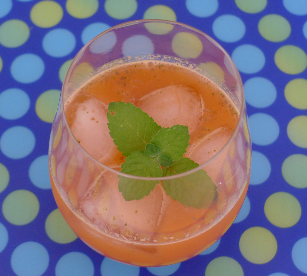 a refreshing glass of orange strawberry ginger mint chia seed cooler