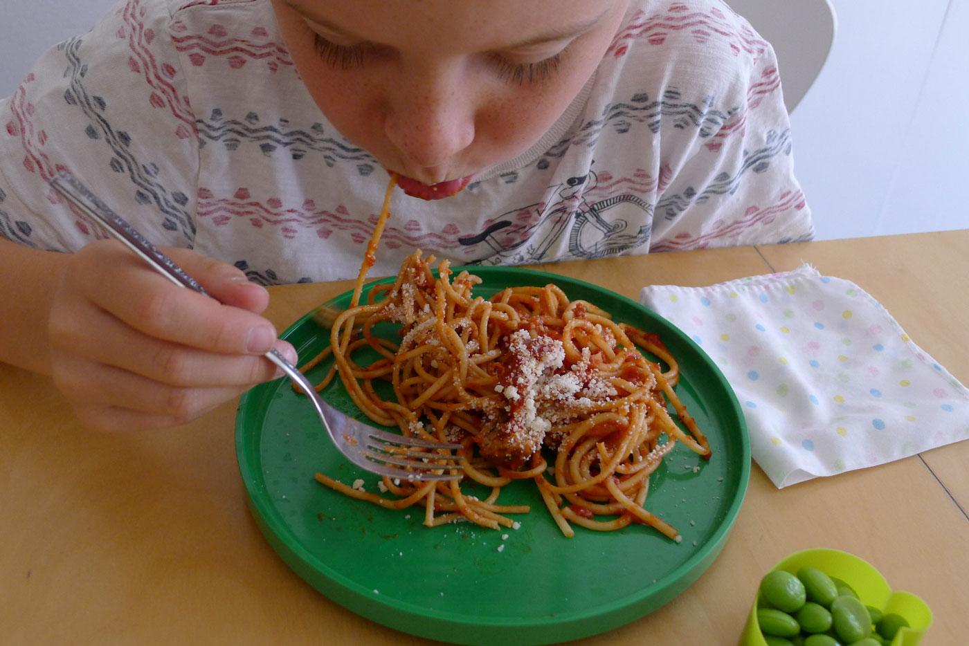 Iain digging into his spaghetti lunch