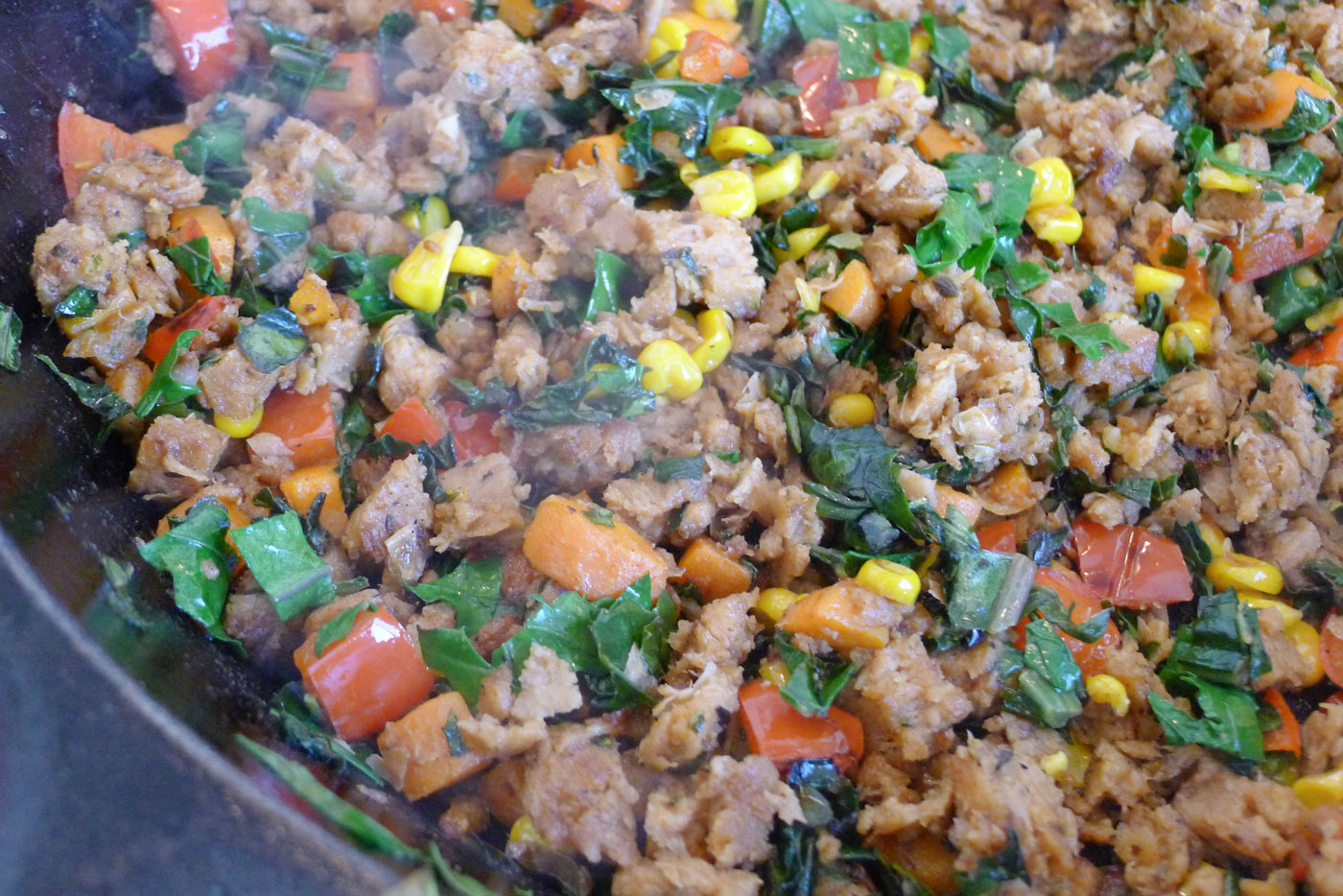 veggie sausage skillet with carrots, onions, corn and kale